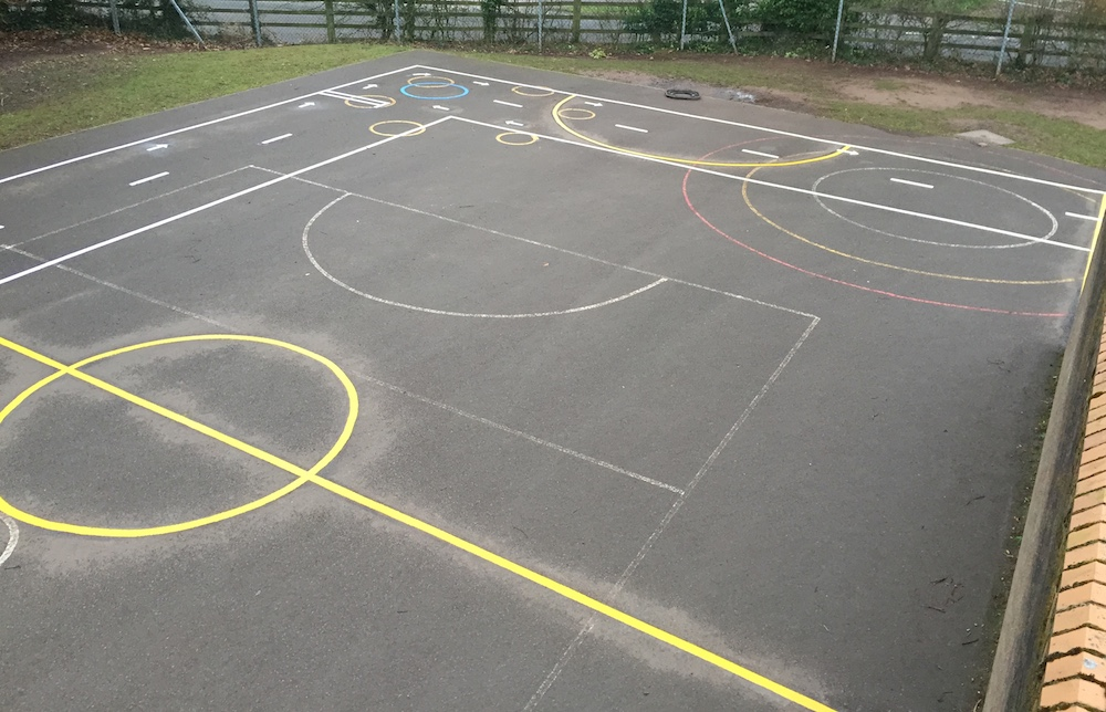 Bespoke football pitch using brick wall and cycle proficiency track as boundaries as well as first4playgrounds markings
