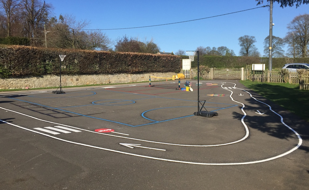 One way bike track around playground markings at Walton Primary School, Northumberland